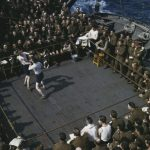 British soldiers watching a boxing match aboard boat from England to North Africa, 1943.