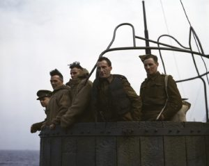 Five British soldiers on a troop ship from England to North Africa, 1943.