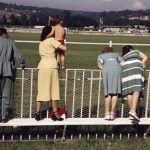 Spectators at the racetrack, Deauville, France, August 1951.